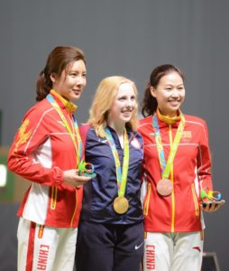 The first gold medalist in the 2016 Rio de Janeiro Olympic Games was the USA's Virginia Thrasher. The 19-year-old athlete from Virginia and West Virginia University is shown with her Olympic gold medal (center) and the silver and bronze medalists, who are both from China. Thrasher began as an active 3-position air rifle shooter.