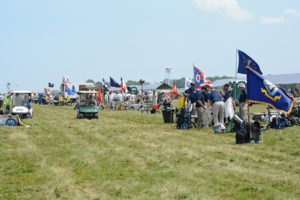 Teams fly their colors along the firing line during the NTT match, proudly displaying from where they come.