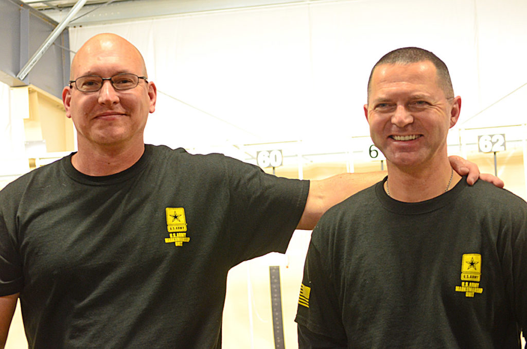 James Henderson (left) and Greg Markowski (right) were the final two competitors in the pistol competition. In the end, Henderson came out on top.