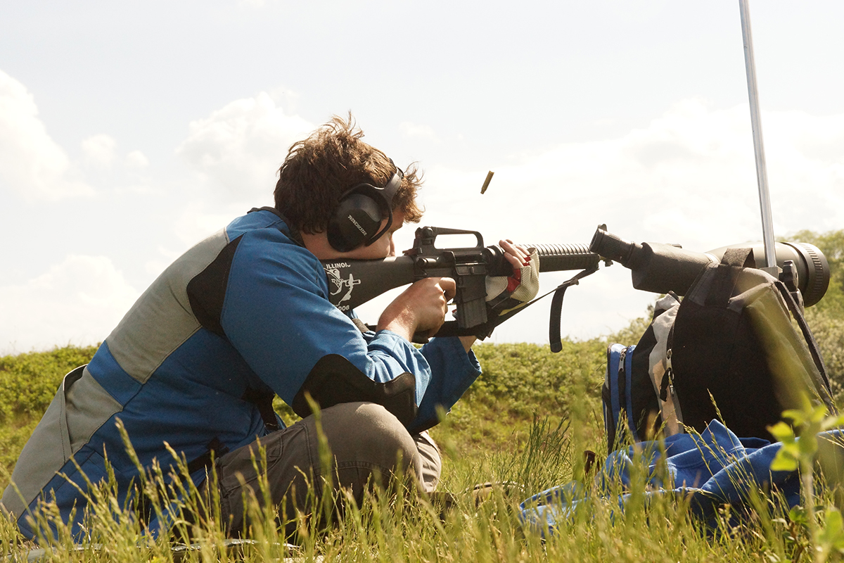 Michael Gaynor in sitting position at the June Triple Crown Match at the Winnequah Gun Club in Lodi, WI.