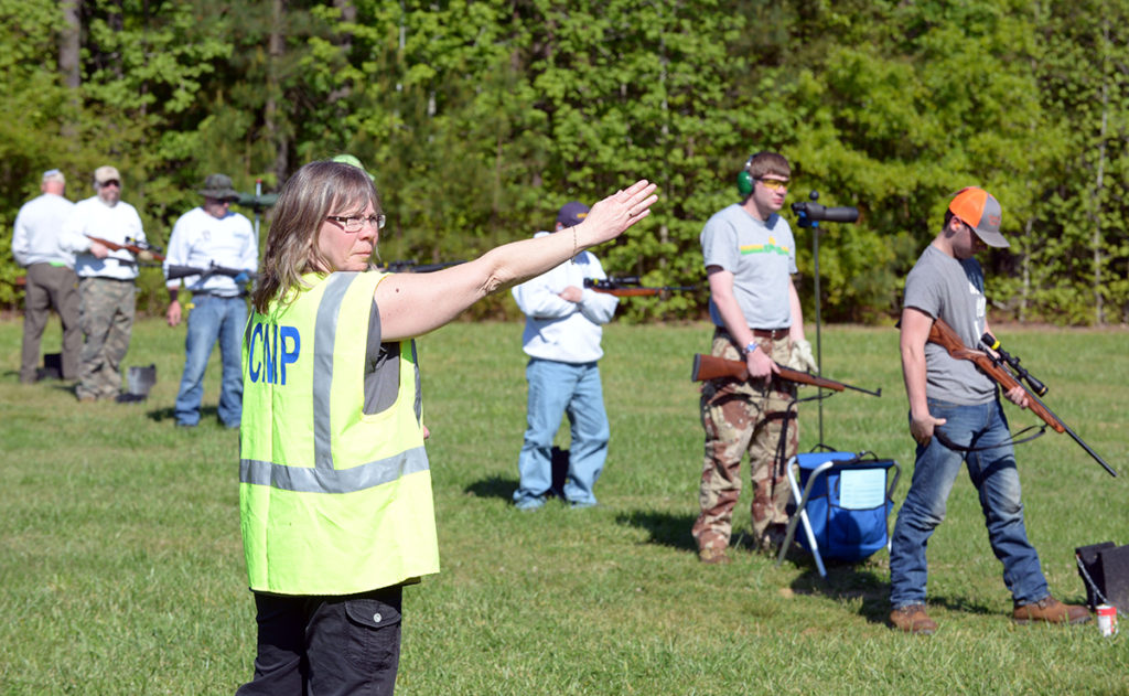 "A CMP Range Officer is signaling to the CRO that ""the line is ready"" in a CMP Rimfire Sporter Match.  A new CMP Range Officer Training Course will soon be available to train volunteer Range Officers to serve in competitions the CMP governs and sanctions."