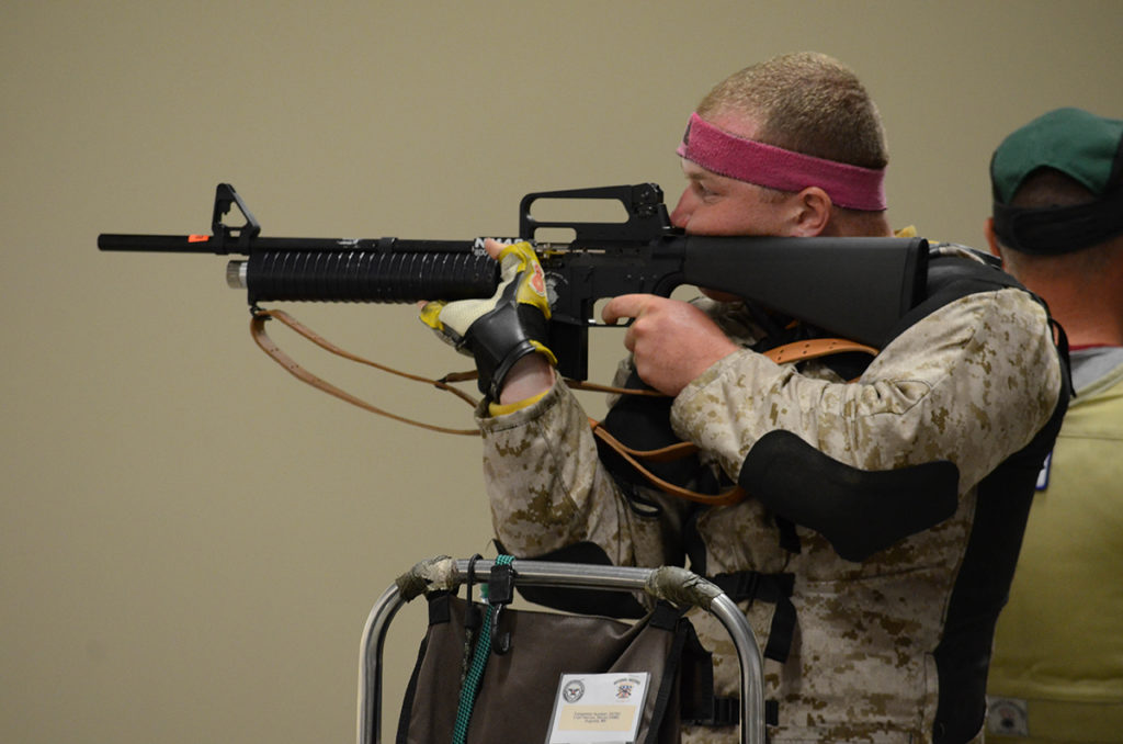During the match, competitors fire National Match Air Rifles in a shoulder-to-shoulder elimination shoot off.