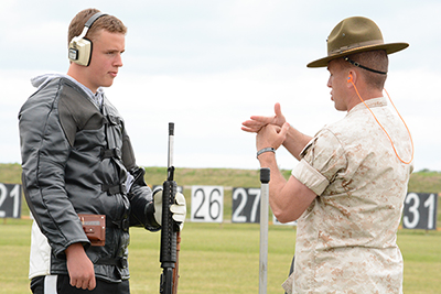 Members of the USMC shooting team used hands-on instruction on the firing line to guide juniors through competition techniques and safety practices.
