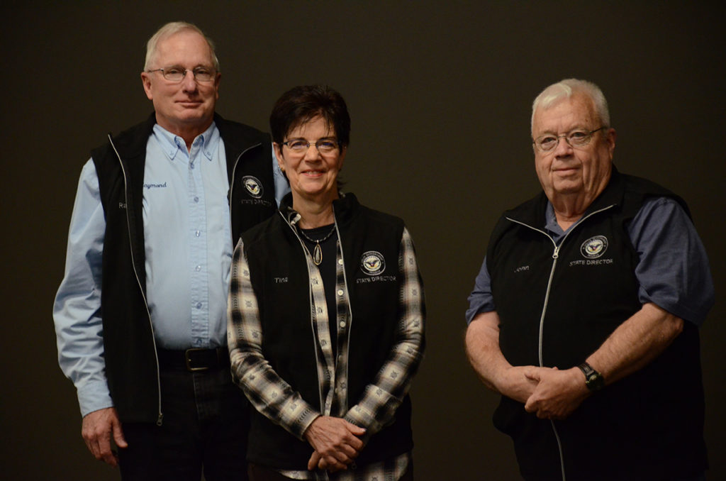 Illinois State Directors Raymond and Tina Odle (left) and Missouri State Director John Leinberger (right) received 15 Year jackets for their service to the CMP.