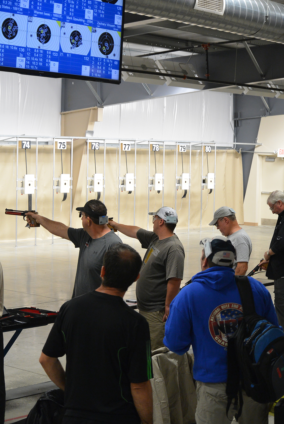 Air Pistol competitors enjoy firing on the the ISSF pistol target as spectators view their shots on the large TV screens above the firing line.
