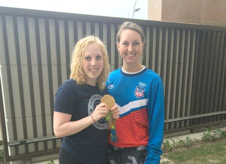CMP Rifle Camps alumni Ginny Thrasher with her gold medal poses with Ashely MacAllister in Rio. Both Ginny and Ashley are past participants in CMP's premier Air Rifle Camps. MacAllister is in Rio as the Rifle Team Coach for Puerto Rico.