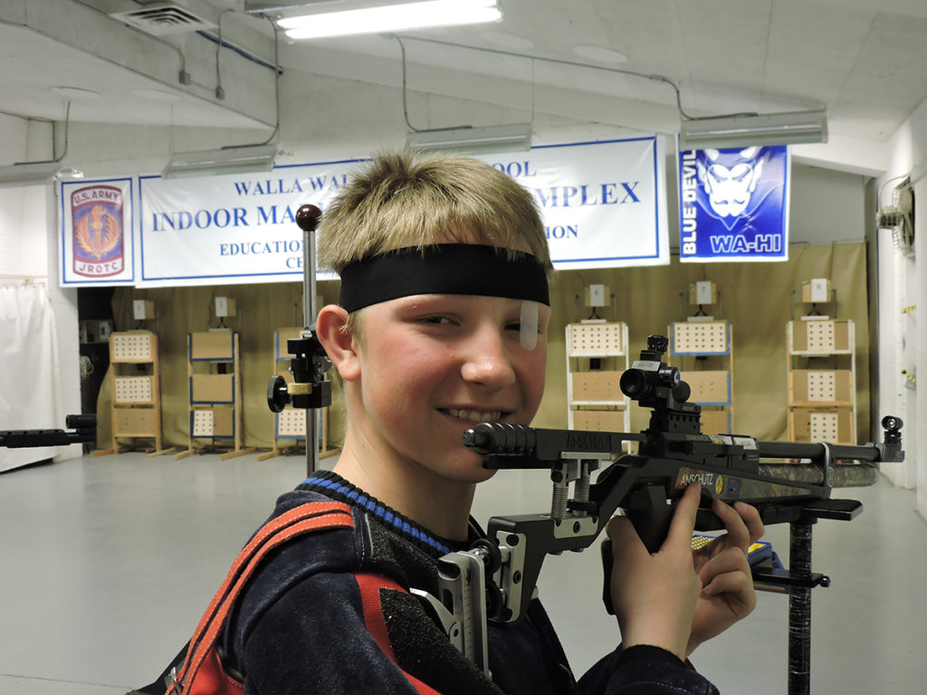 Built for marksmanship, Walla Walla High School has contained a JROTC rifle range since 1906. Today, the range is equipped with electronic targets while also accommodating to paper (shown here by Cadet PFC Brock Betzler) – giving the team ample practice opportunities.