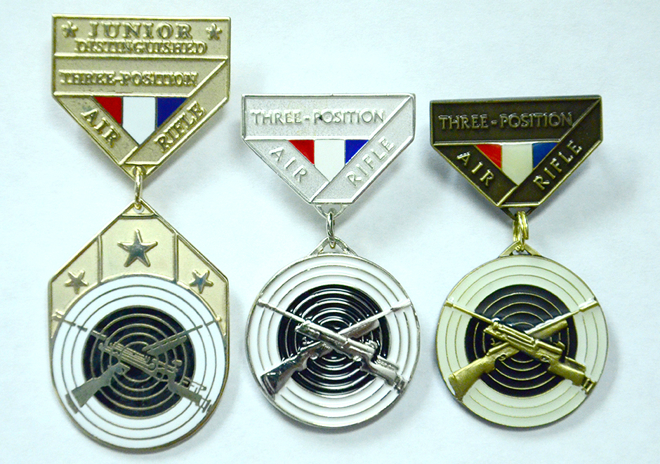 CMP awards bronze and silver EIC badges along with the gold Junior Air Rifle Distinguished Badge.