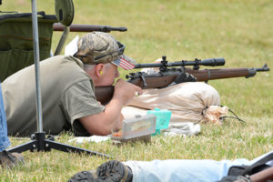 Competitors use scoped, as-issued vintage sniper rifles or replica rifles from the Korean War, World War II or earlier eras set atop provided sandbags.