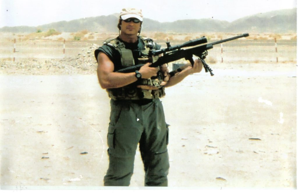 Steve Sciarabba with his M24 Sniper Weapon System (SWS) on mission with US Armed Forces, Afghanistan in 2004