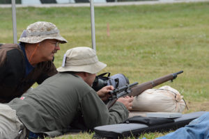 Members of two-person teams take turns as shooter and spotter at each distance. Each member is responsible for guiding his or her teammate to achieve the optimum score.