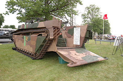 A World War II AMTRAC, amphibious beach landing craft, was brought on a large truck bed and set up for display in the Petrarca Range parking lot. Spectators were able to climb inside of the vehicle for an up close look.