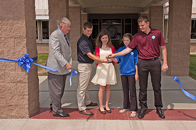 Anderson was joined by two junior marksmen and his grandchildren for the ribbon cutting. Left to right: Ian Foos, Brooke Nofzinger, Annalise and Max Georgi.