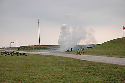 "Ground pyrotechnics simulated a real aerial assault from the planes above. Anti-aircraft units on the ground ""fired back"" during the reenacted battle."