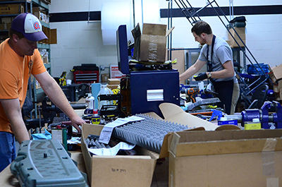 Chris Hord (left) and Ryan Lindell (right) work alongside McLean as armorers in the Custom Shop.