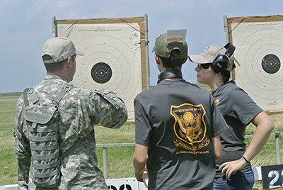 Besides fundamentals of pistol use, SAFS students also learn how to score and other key aspects of competition pistol shooting.